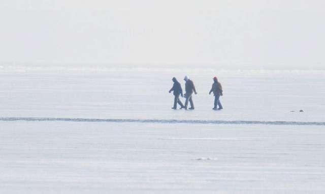 Three men walk