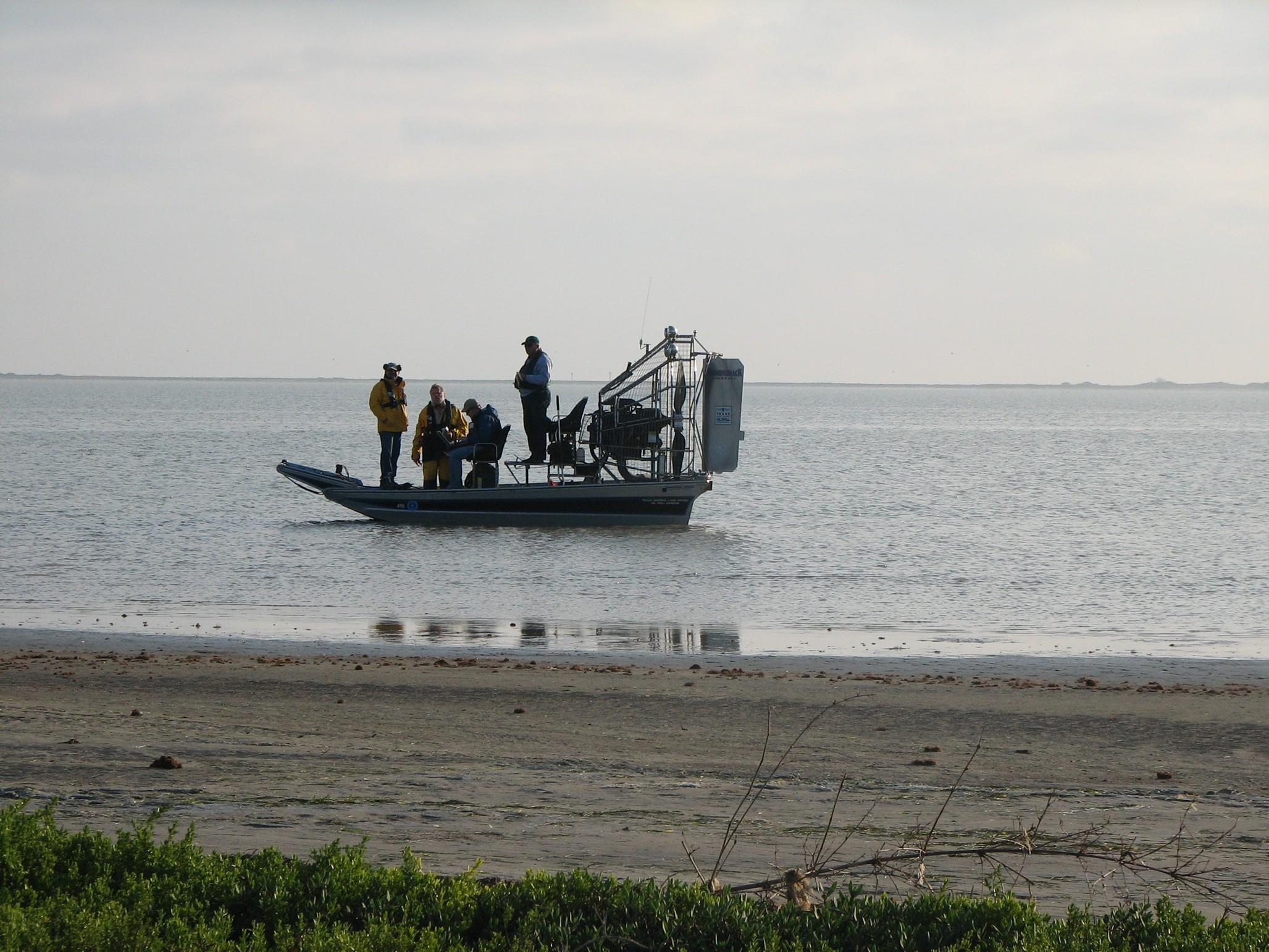 Chris is logging data while I walk the tidal flat looking for mat algae / photo: Mark Finkbeiner